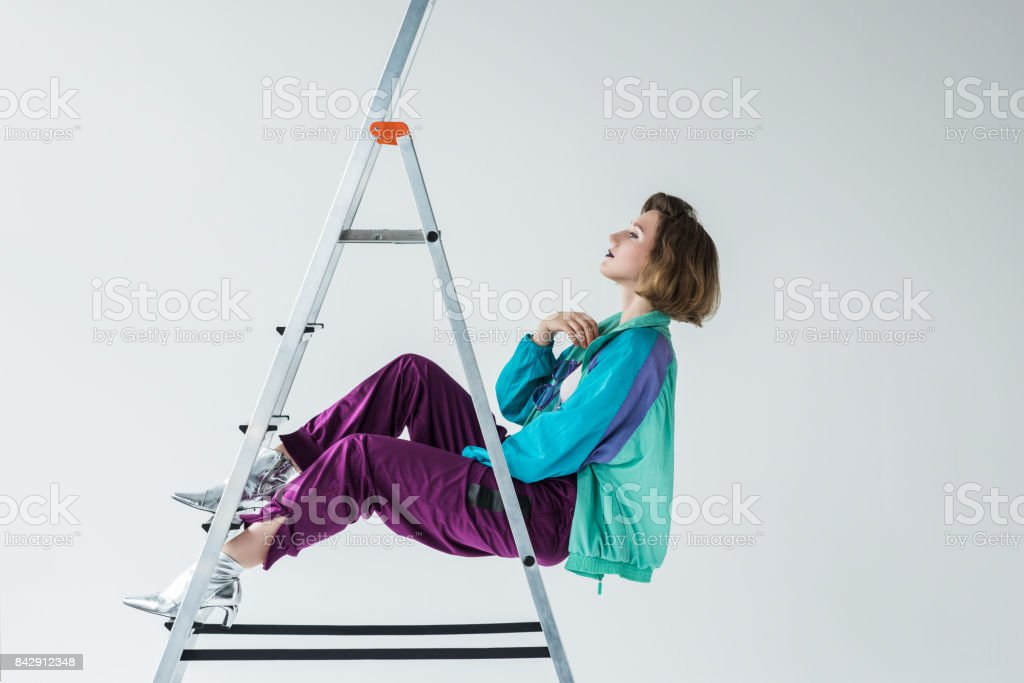 young girl in vintage windcheater suit stock photo