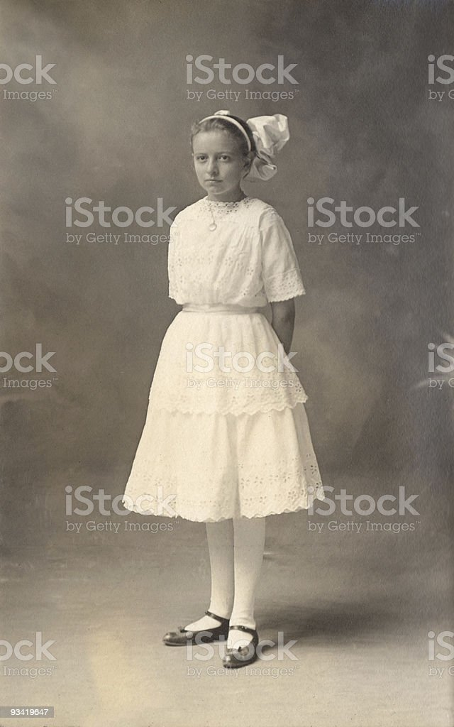 Young girl in white dress, 1908 royalty-free stock photo