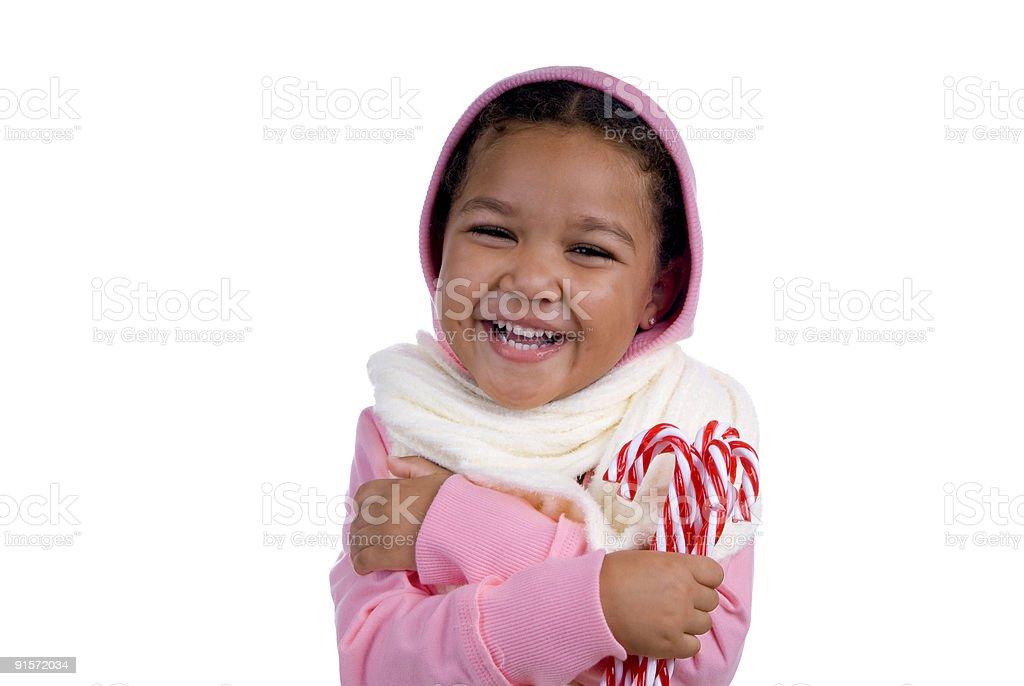 137e73695b37 Giovane ragazza in abbigliamento invernale con Bastoncini di zucchero foto  stock royalty-free