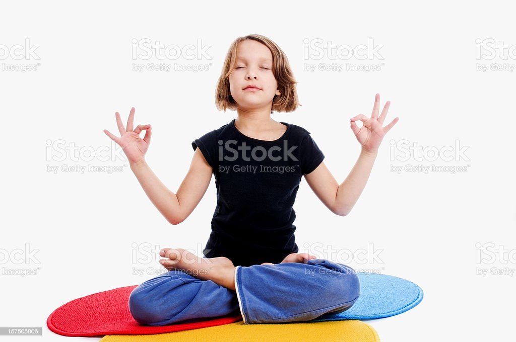 Young Girl in Yoga Meditation Pose royalty-free stock photo