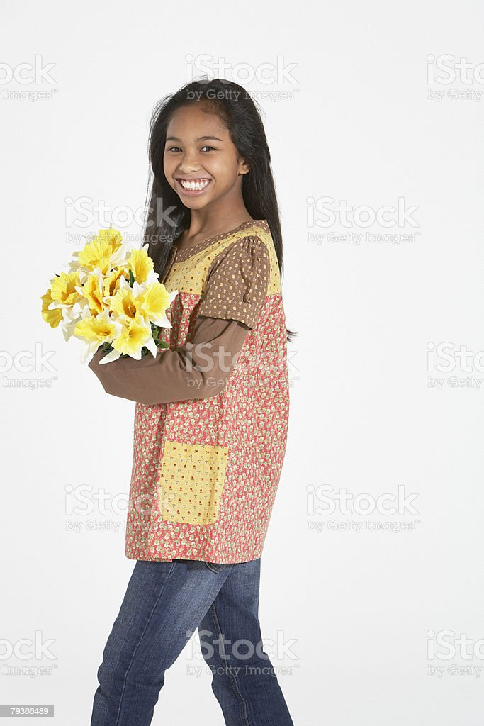 Young girl indoors holding bouquet of flowers 免版稅 stock photo