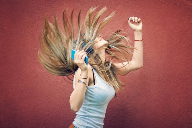 young girl is dancing and listening the music - pics for cool girl stock pictures, royalty-free photos & images