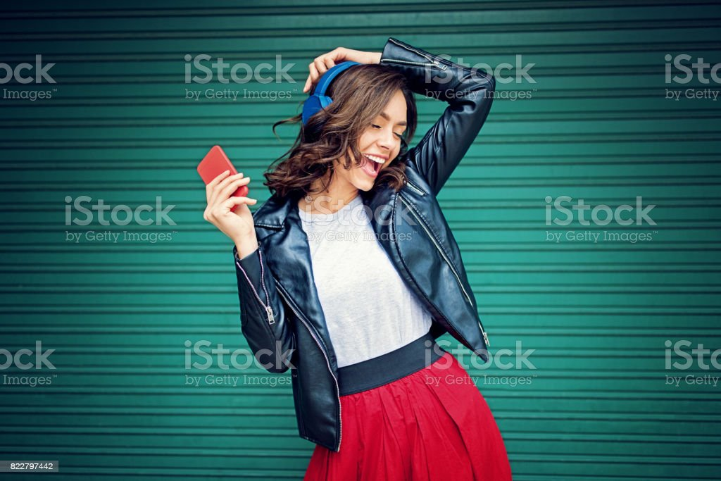 Young girl is dancing and listening the music stock photo