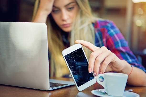 young girl is devastated after her mobile phone is fall down. - broken iphone stock photos and pictures