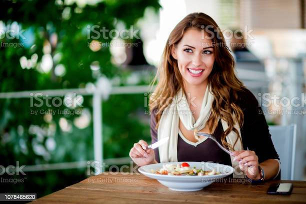 Young girl is eating salad in the restaurant picture id1078465620?b=1&k=6&m=1078465620&s=612x612&h=wargfu1tj3v8ivzxvabctvoo5ur0bpysgcssvapcxm0=