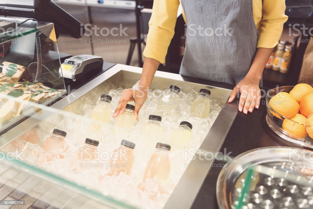 Young girl is holding chilled drink stock photo