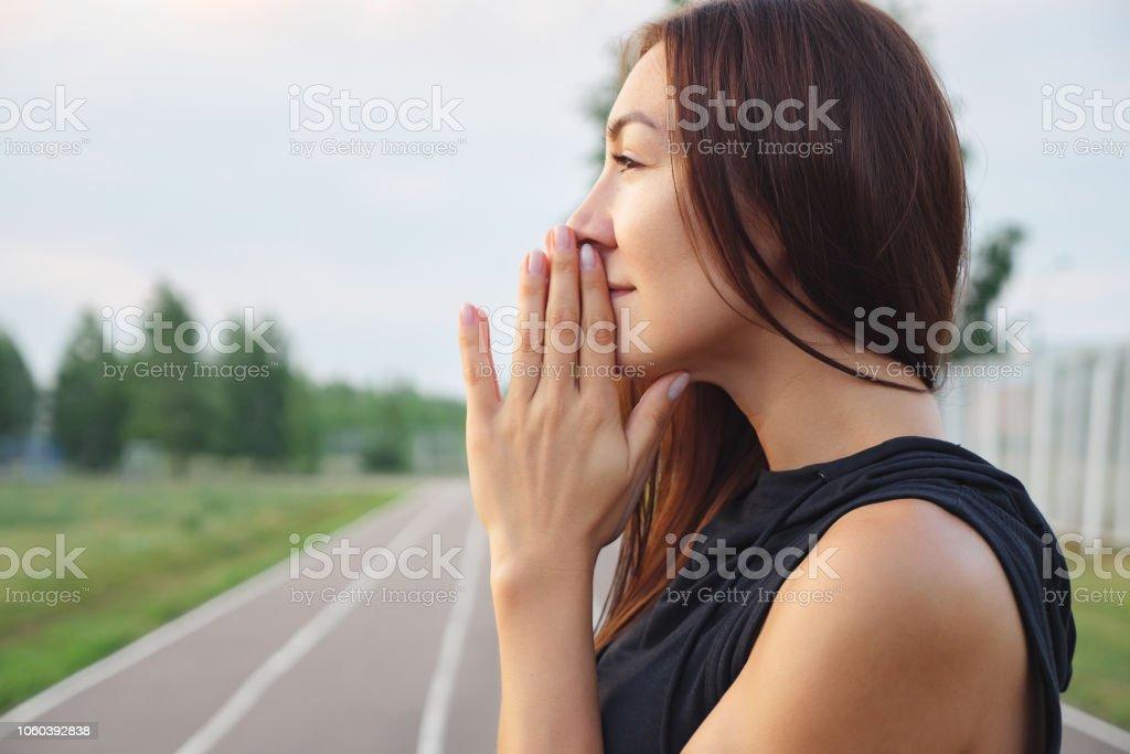 Young girl is holding hands together like praying - Zbiór zdjęć royalty-free (Aktywny tryb życia)