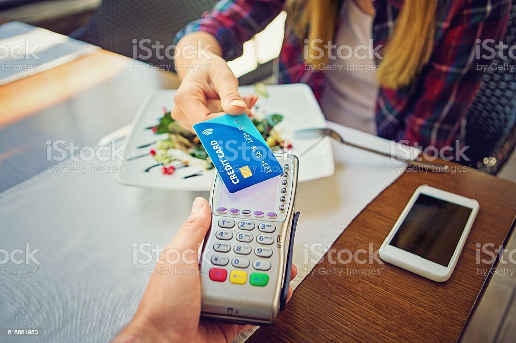 Young girl is paying using her credit card stock photo