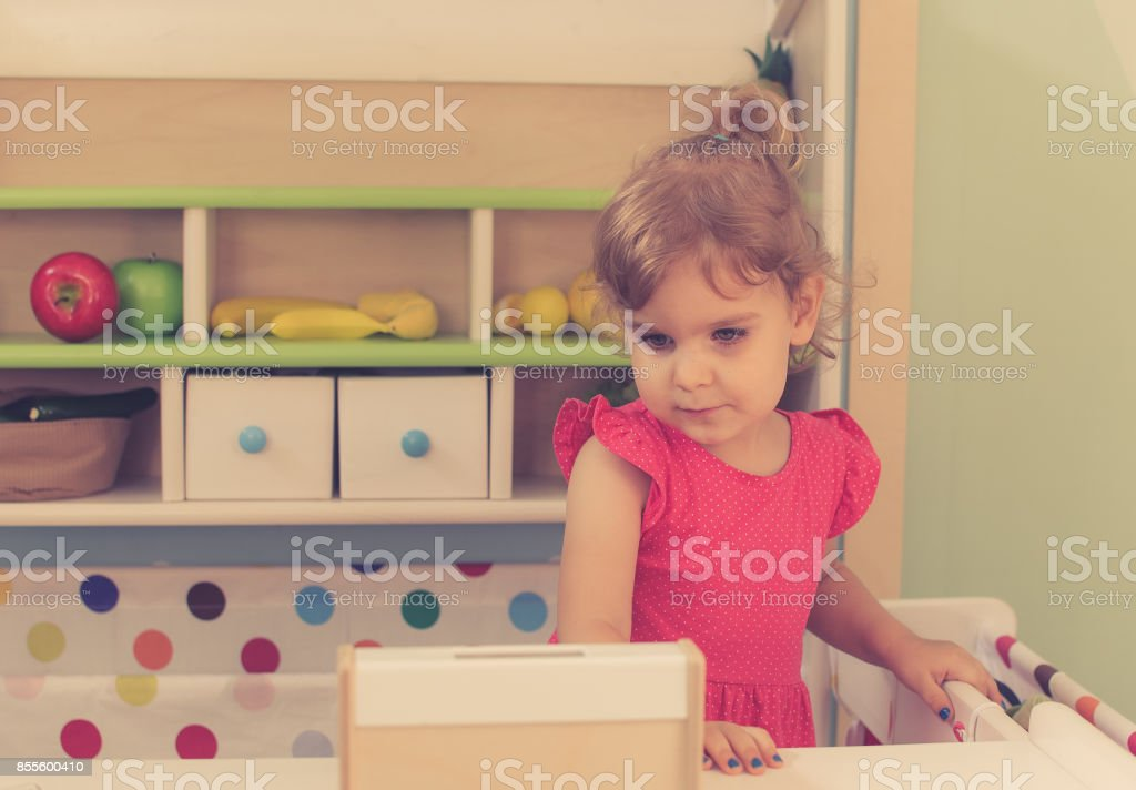 Young girl is playing in kindergarten stock photo