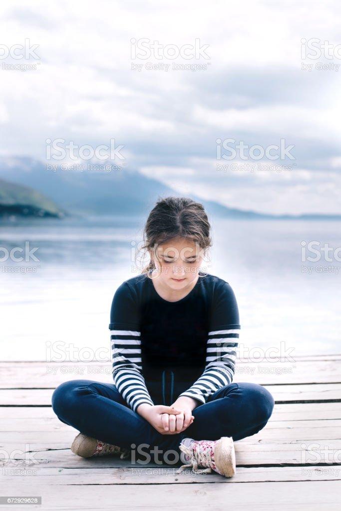 Young girl is playing with ladybug stock photo