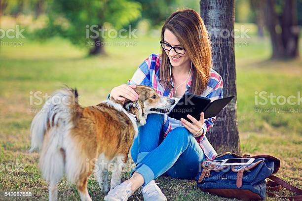 Young girl is reading from her ebook picture id542687888?b=1&k=6&m=542687888&s=612x612&h=anmm46j7isr dqme  gg9klqp7ggx68vhx8wol5znlk=