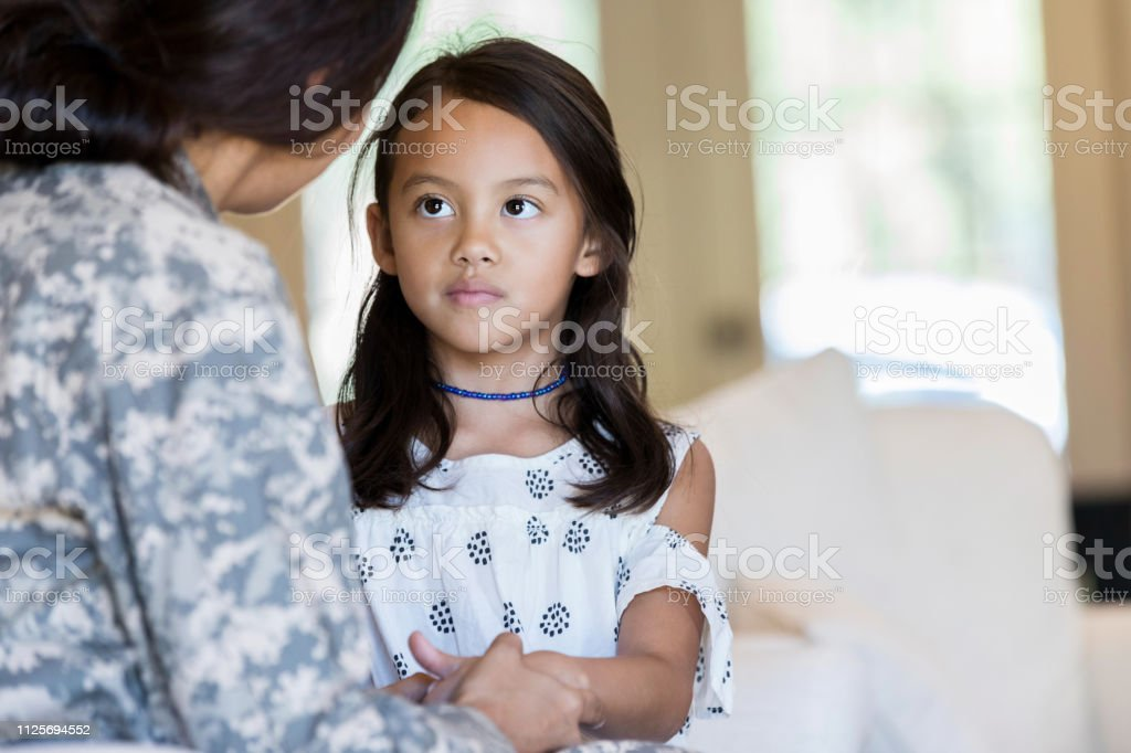 Young girl is sad to see her mom leave for military duty - Royalty-free Adult Stock Photo