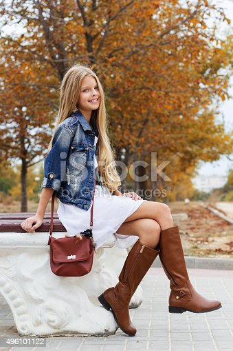 istock Young girl is swearing boots and dress 496101122