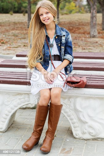 istock Young girl is swearing boots and dress 496101138