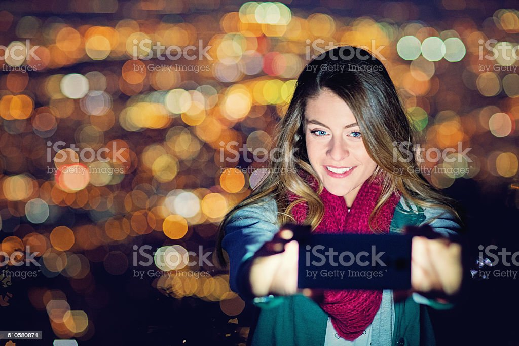 Young girl is taking selfie in the night stock photo