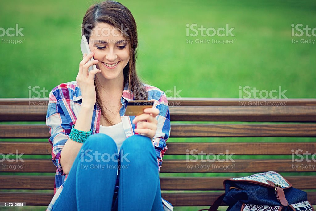 Young girl is talking using her mobile phone stock photo