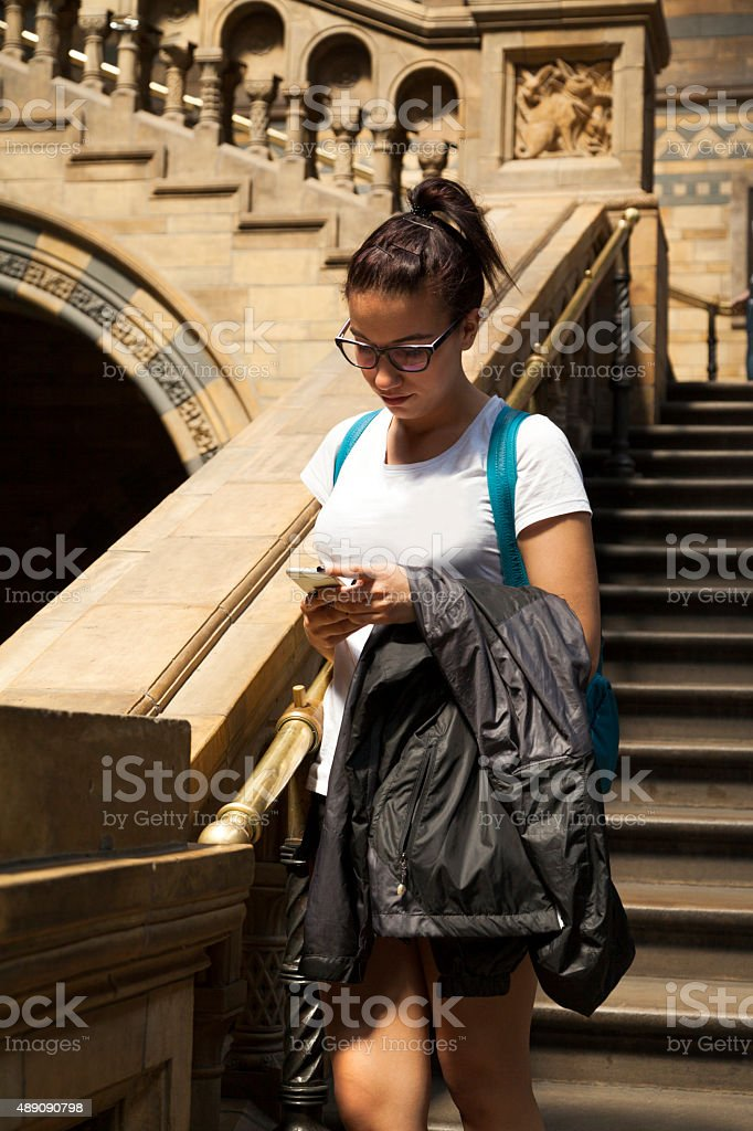 Young girl is using smart phone stock photo