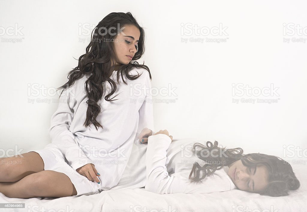 Young girl is waking up again. stock photo