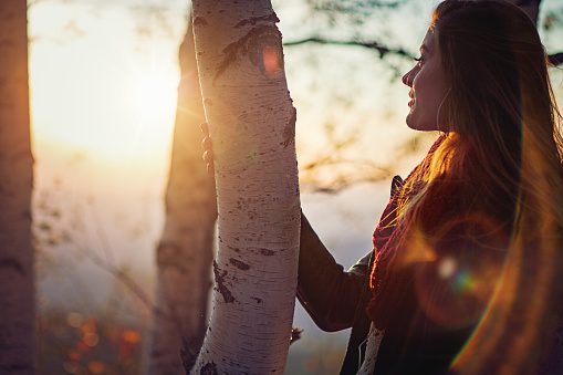 istock Young girl is watching the sunset in mountain 613146886