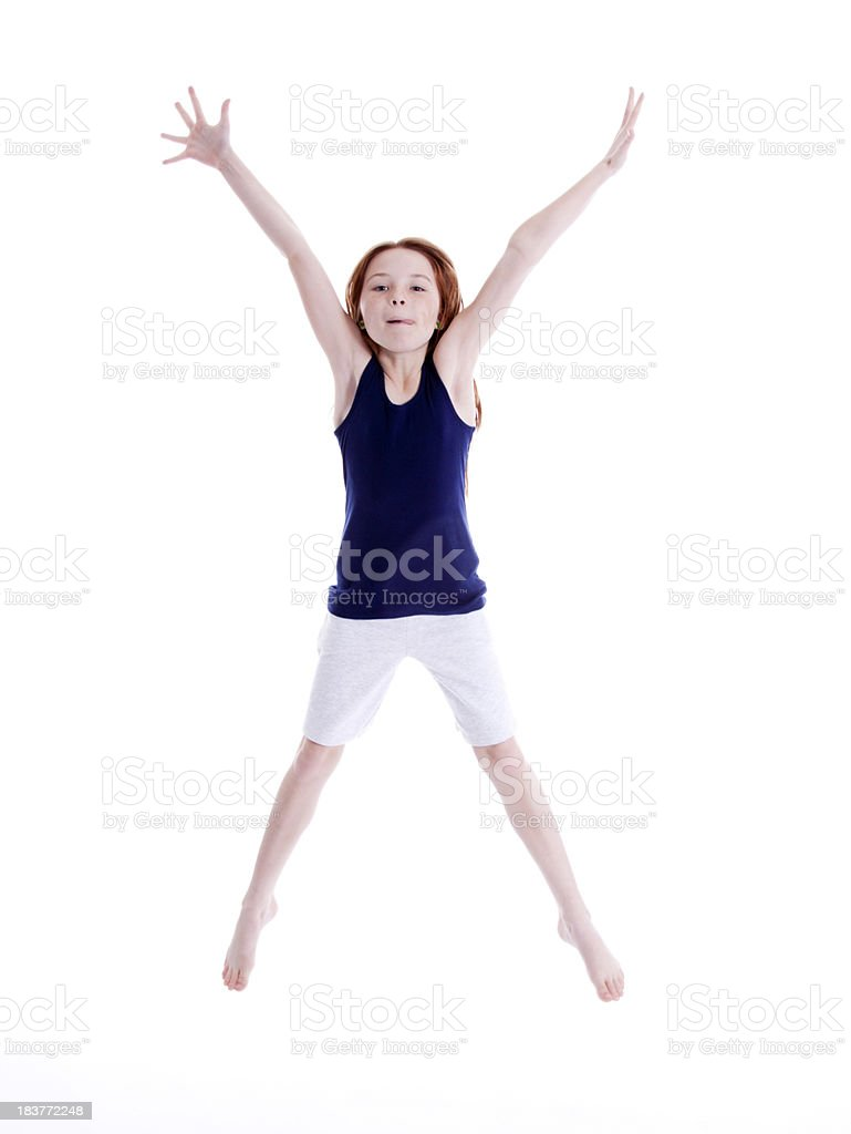 Young Girl Jumping for Joy stock photo