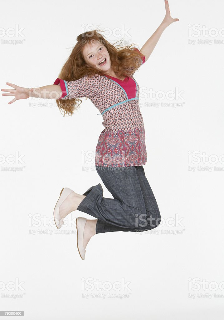 Young girl jumping indoors royalty-free stock photo