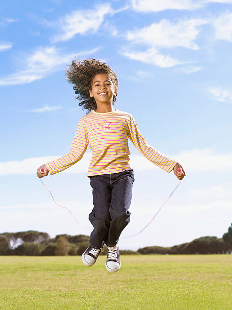 Young girl jumping rope stock photo