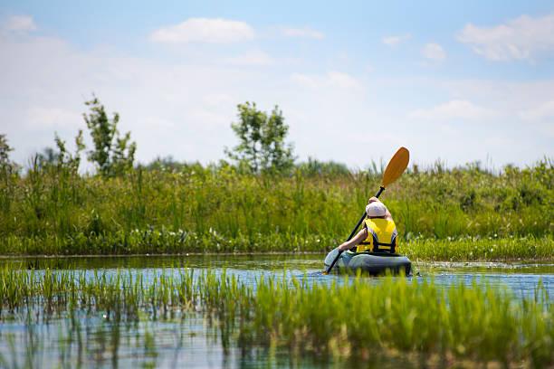 Young girl kayaking stock photo