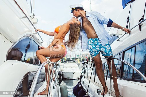 Young girl kissing with her boyfriend on yacht, Malta
