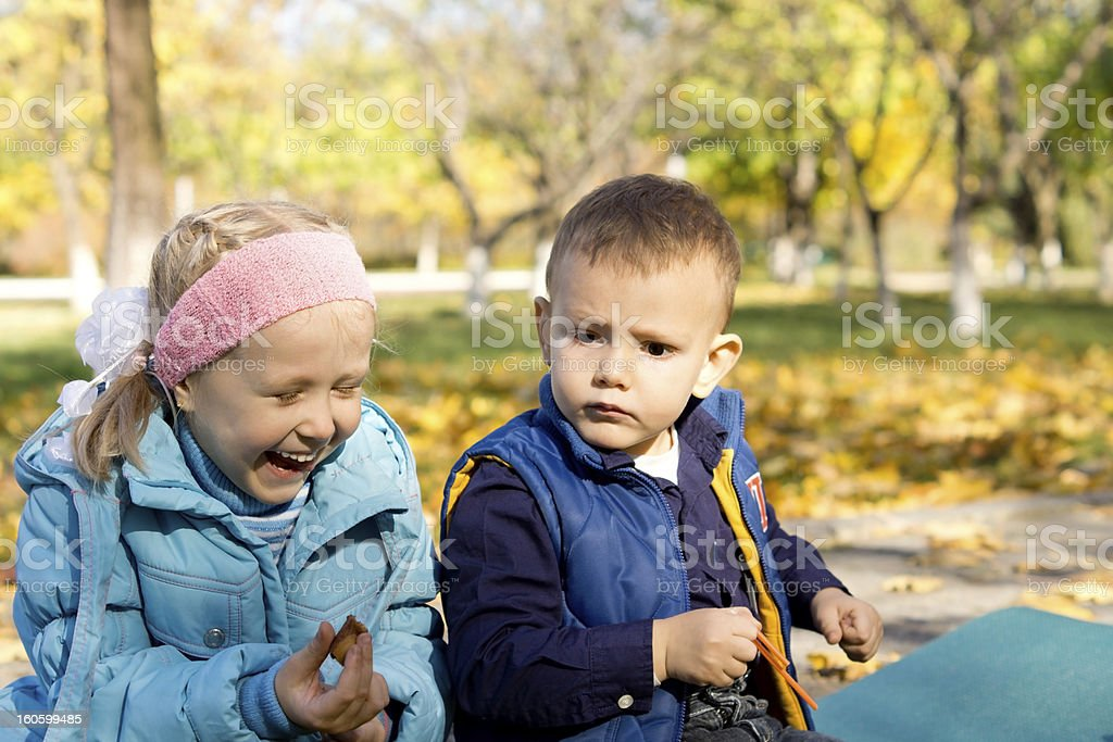 Young Girl Laughing in Outdoor Autumn Setting royalty-free stock photo