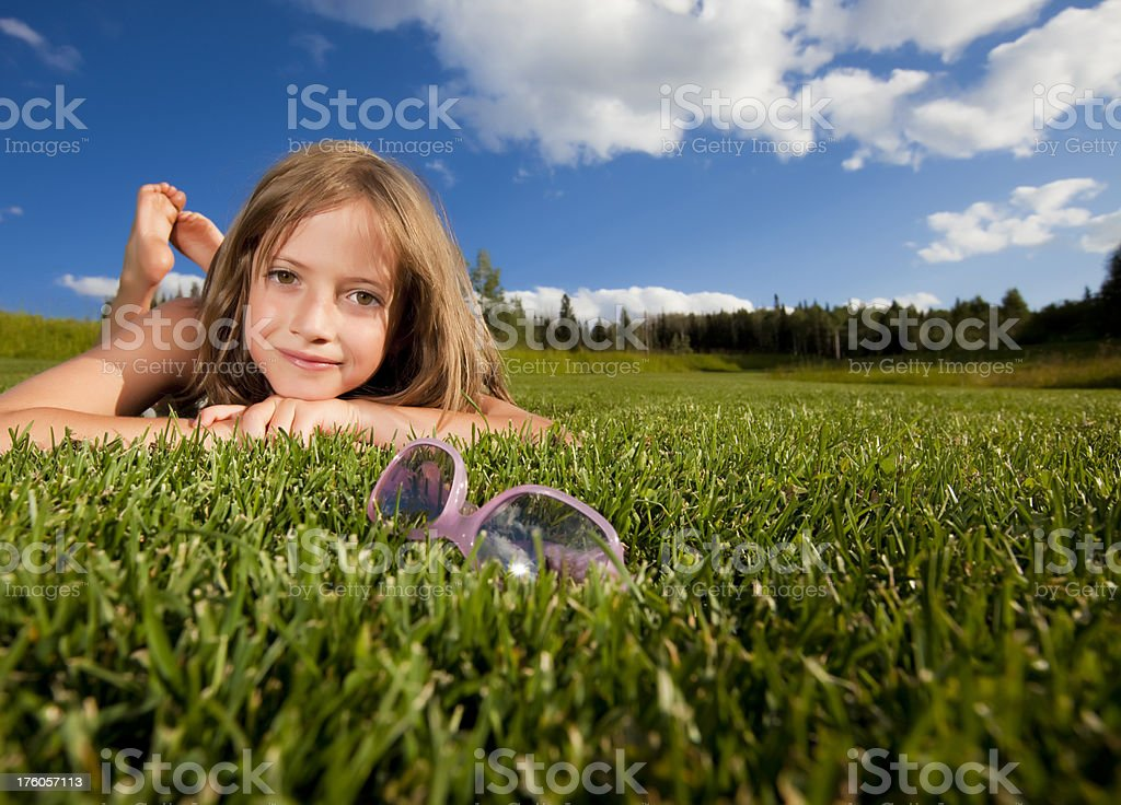 Young girl laying in grass royalty-free stock photo
