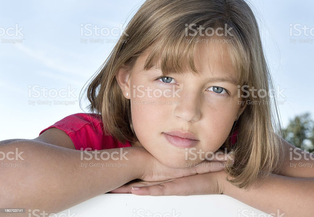 Young girl leaning on her hands royalty-free stock photo