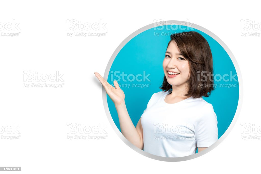 Young girl leaning out of the round window. stock photo