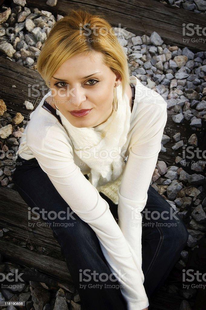 Young girl lies on the railway stock photo