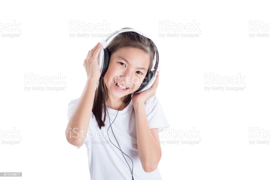 Young girl listening music from headset over white stock photo