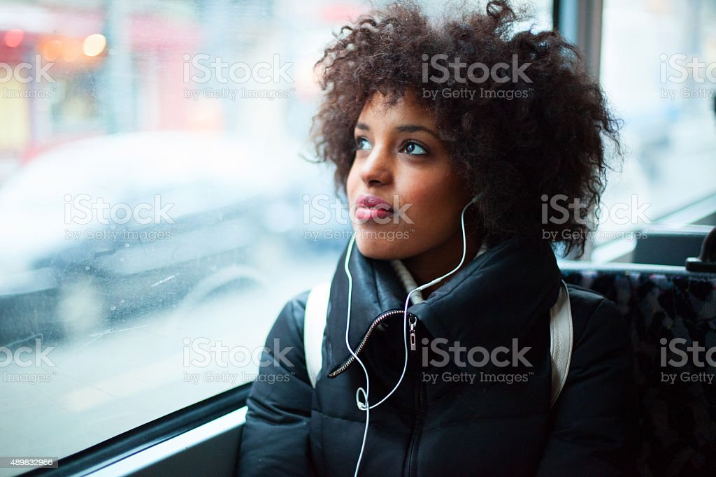 Young girl listening to music on public transport royalty-free stock photo