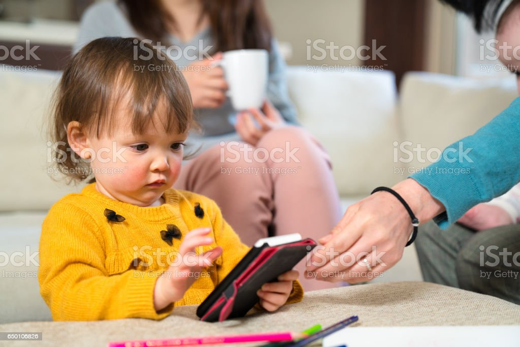 Young girl looking a smartphone stock photo
