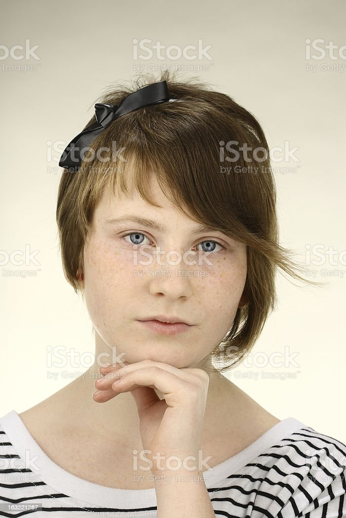 Young girl looking at the camera, hand on chin royalty-free stock photo