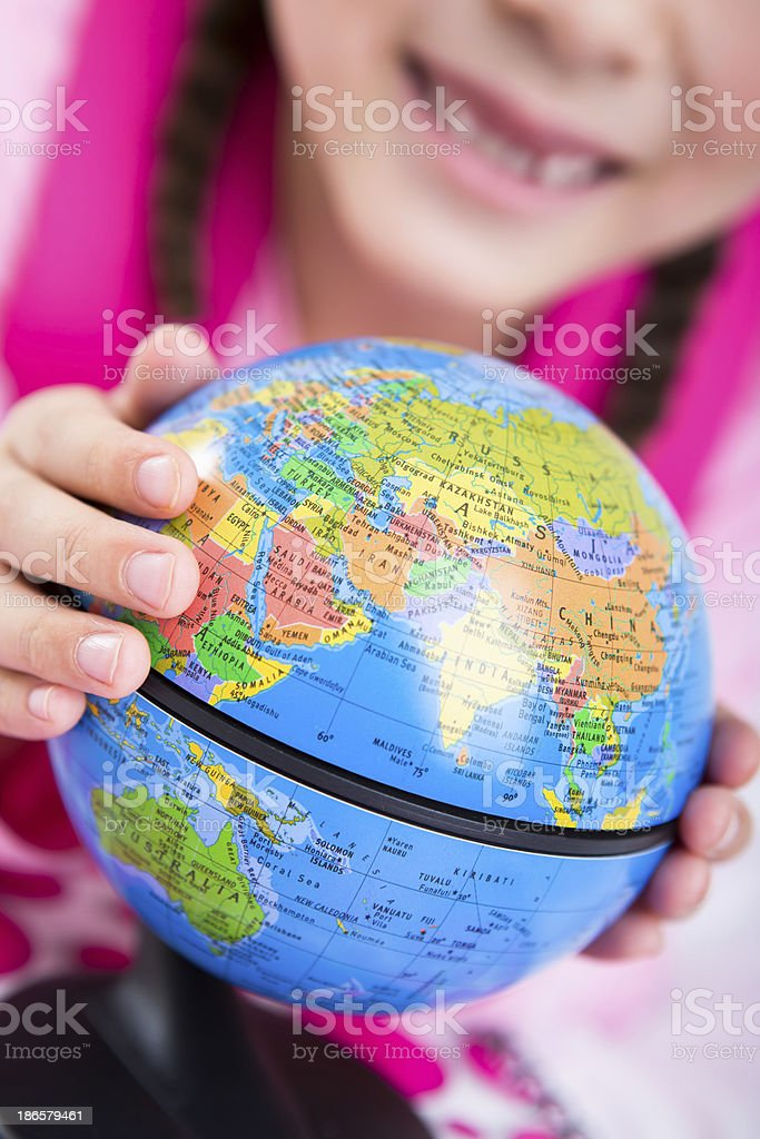 Young girl looking at the globe royalty-free stock photo