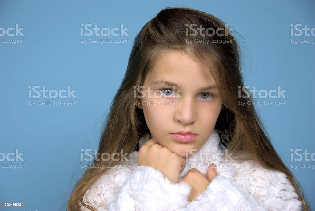 Young girl looking serious stock photo