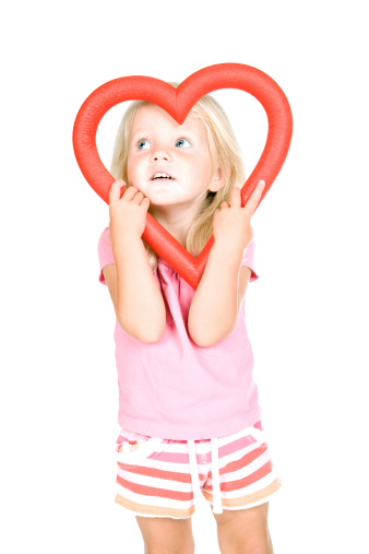 Young Girl Looking Through a Heart