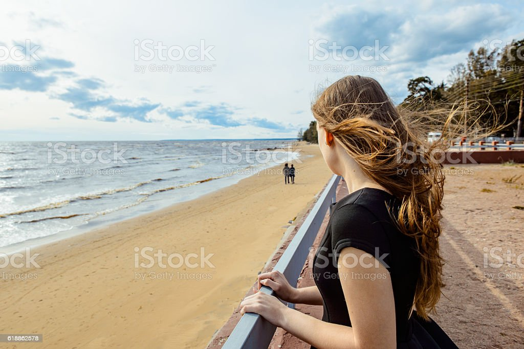 Young girl looks at a couple in love stock photo