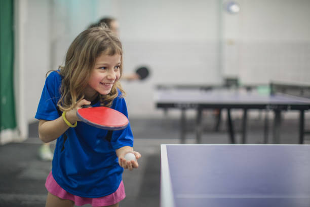 young girl loves table tennis - racket sport stock pictures, royalty-free photos & images