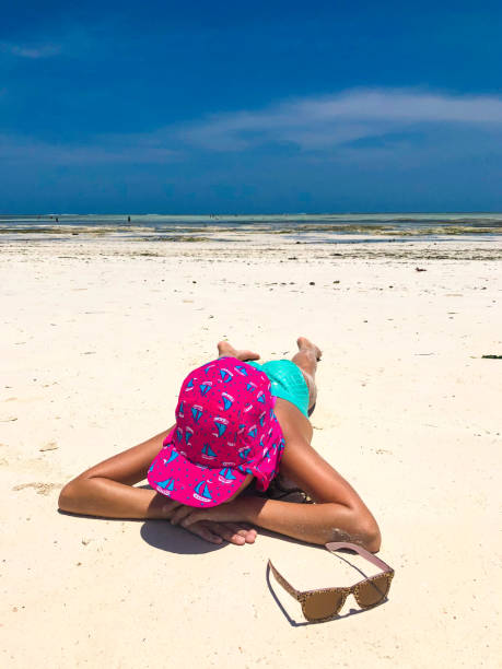 Young Girl Playing On Sandy Beach Stock Photo - Download