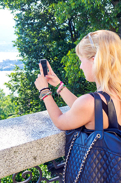 Young girl make photos with a smartphone. Color image stock photo
