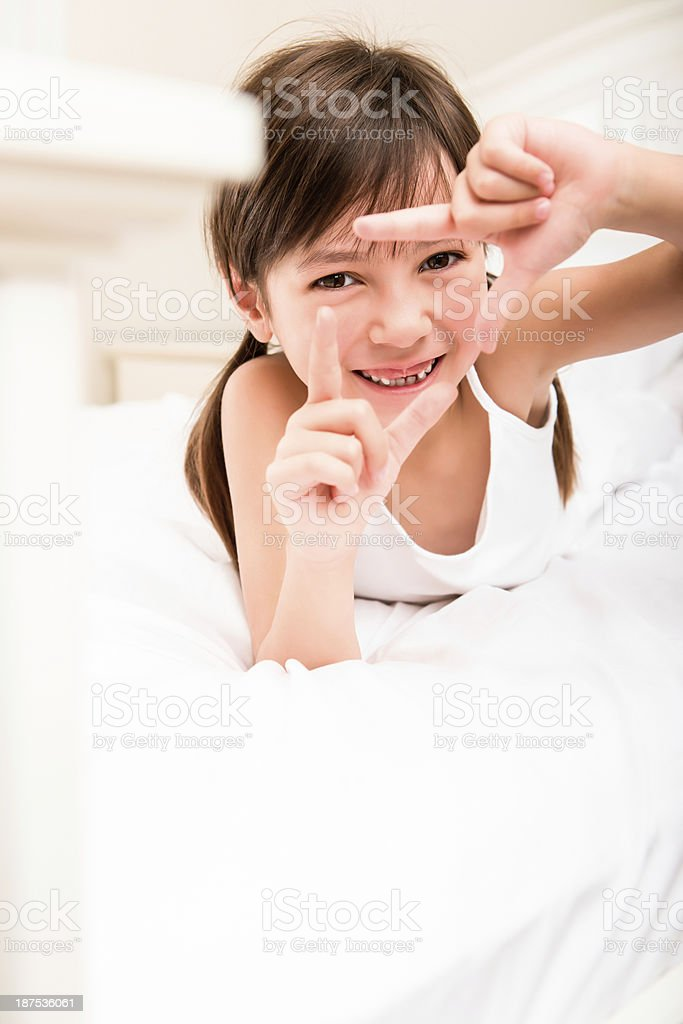 Young girl making a frame with her hands royalty-free stock photo