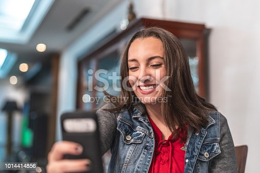 istock Young Girl Making a Video Chat at Home 1014414856