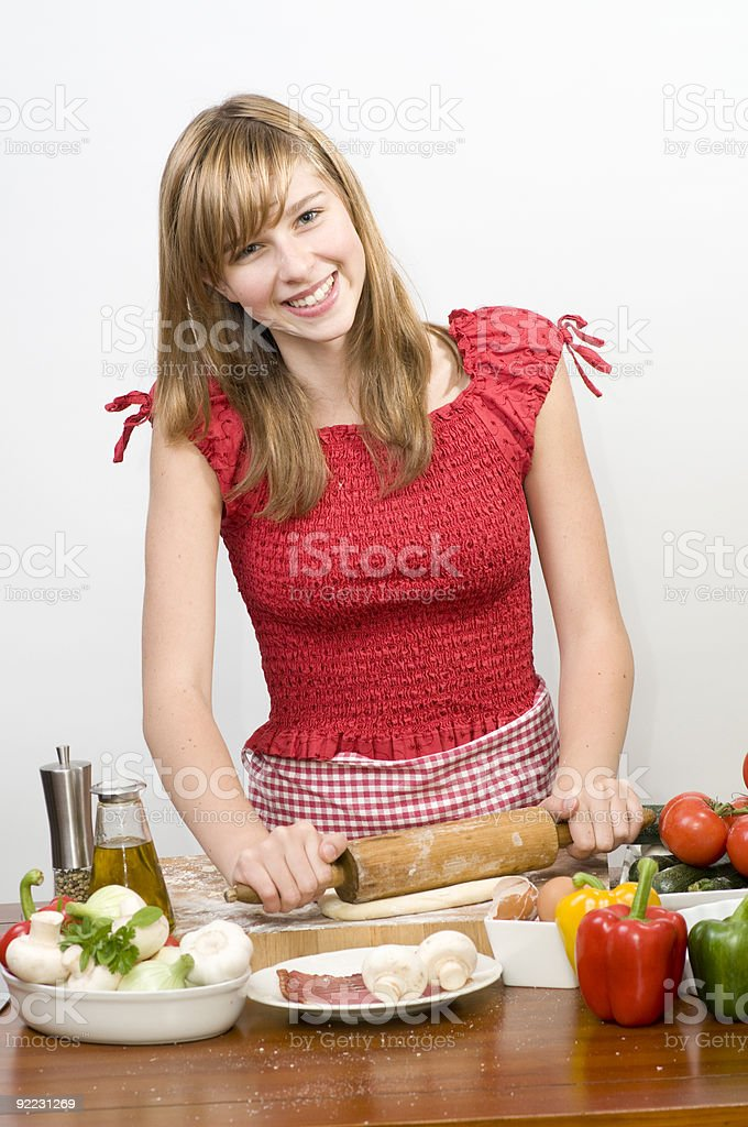 Young girl making pizza royalty-free stock photo