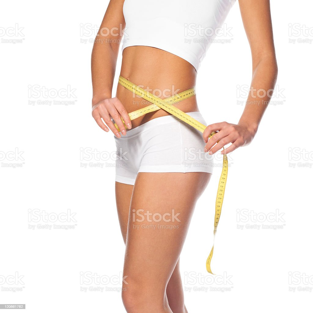 young girl measuring perfect shape of beautiful hips royalty-free stock photo