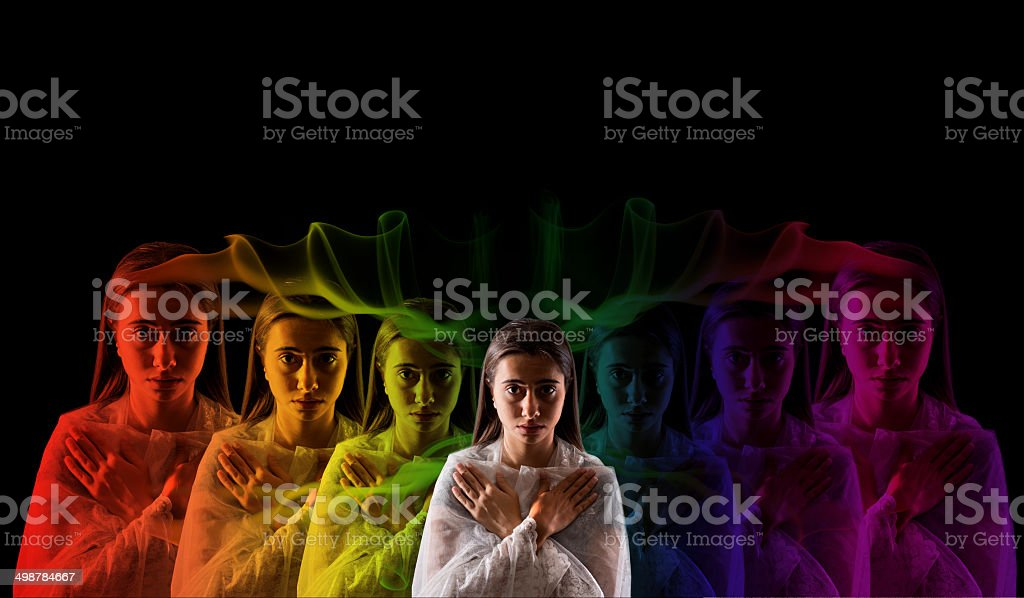 young girl meditating with aura  colors stock photo