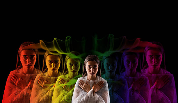 young girl meditating with aura  colors - aura stock photos and pictures
